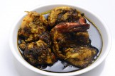 PRAWNS COOKED IN GARLIC DIL LEAVES AND SPINACH